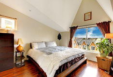 Nice bedroom with vaulted ceiling Royalty Free Stock Photo