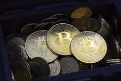 Bitcoin coin crypto finance business dark ramdom. Nice bitcoin coins in wood chest close up Royalty Free Stock Photos
