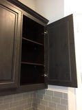 Nice black cupboard in a new house Royalty Free Stock Photos