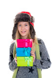 Nice blond girl with gift boxes, cap and scar Royalty Free Stock Photos