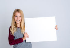 Nice blond girl showing a white sign Royalty Free Stock Images