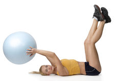 Nice blond keeping a big fitness ball Royalty Free Stock Image
