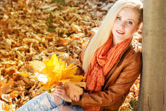 Nice blonde girl in autumn park Royalty Free Stock Photography
