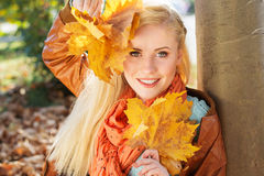 Nice blonde girl in autumn park Royalty Free Stock Image