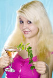 Nice blonde girl  holds in hand glass and  mint Royalty Free Stock Photography