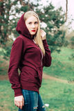 Nice blonde girl in a hoodie Royalty Free Stock Images