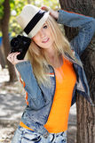 Nice blonde girl photographer with camera Stock Photography