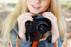 Nice blonde girl photographer with camera Stock Photos
