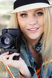 Nice blonde girl photographer with camera Stock Images