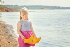 Nice blonde girl posing with homemade paper boat Stock Photos