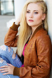 Nice blonde girl is wearing autumn clothes Stock Image