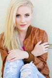 Nice blonde girl is wearing autumn clothes Stock Photos