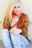 Nice blonde girl is wearing autumn clothes Royalty Free Stock Photography