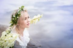 Nice blonde girl with white flower wings royalty free stock photo