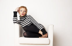 Nice blondgirl on the chair Royalty Free Stock Photography