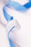 Nice blue and silver satin ribbons Royalty Free Stock Images