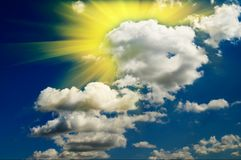 Nice  blue sky with clouds and   fun sun. Stock Photo