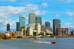 Nice summer day London Canary Wharf United Kingdom. Nice blue sky with white fluffy clouds over Canary Wharf viewed from the west.Canary Wharf is a major private Royalty Free Stock Photos