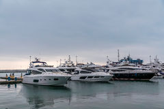 Nice boats and yachts at the pier the sea port Sochi; Russia. Royalty Free Stock Image
