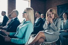 Nice bossy classy stylish lady attending forum listening to top management conference company sales educative classes. Courses sitting on chair talking mobile royalty free stock photography
