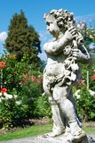 Nice botanic garden with statue Royalty Free Stock Photos