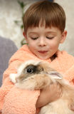 The nice boy. Holds on hands of the rabbit Stock Photo