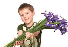 The nice boy. With a bouquet flowers Stock Photo