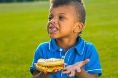 Nice boy has a breakfast. Stock Photo