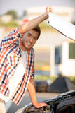 Nice boy opening bonnet Royalty Free Stock Photography