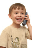 The nice boy speaks by phone. On a white background Stock Photography