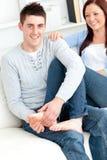 Nice boyfriend massaging his girlfriend's feet Stock Image