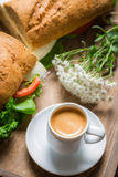 Nice breakfast with coffee, sandwich and flowers Stock Photos