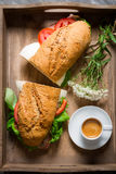 Nice breakfast with coffee, sandwich and flowers Royalty Free Stock Photo