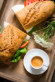 Nice breakfast with coffee, sandwich and flowers Royalty Free Stock Images