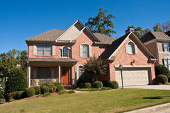 Nice Brick House with a Brown Door royalty free stock image