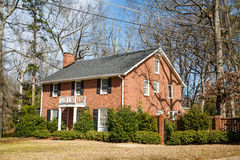 Nice Brick House on Winter Lawn Royalty Free Stock Photography