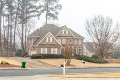Nice Brick House wtih New Snow Falling Stock Photography