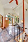 Nice bright entry way to home with high vaulted ceiling, tile floor and staircase. Stock Images