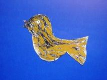 Beautiful painted bird on blue background Royalty Free Stock Image