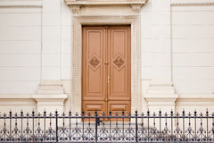 A nice brown door. On the wall Royalty Free Stock Photo