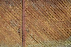 Wooden door at the harbor shed in Lübeck stock photos