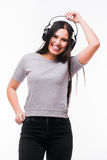 Nice brunet girl listen dancing to music with headphones Stock Images