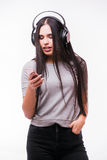 Nice brunet girl listen dancing to music with headphones Royalty Free Stock Images