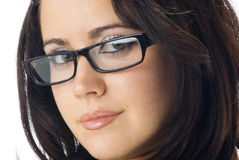 Nice brunette. A nice portrait of young and really cute brunette with black glasses royalty free stock photography
