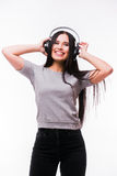 Nice brunette girl listen dancing to music with headphones Royalty Free Stock Image