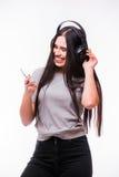 Nice brunette girl listen dancing to music with headphones Stock Image