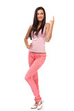 Nice brunette young woman pointing at copyspace Royalty Free Stock Photo