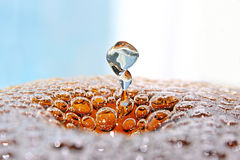 Nice bubbles with whirling drop. Royalty Free Stock Photography