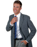 Man corrects a hand a tie Royalty Free Stock Photo