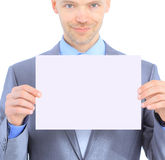 Nice businessman holds white poster Royalty Free Stock Image